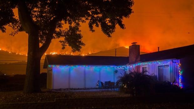 The Thomas Fire advances toward Santa Barbara County seaside communities on Sunday in Carpinteria, Calif.