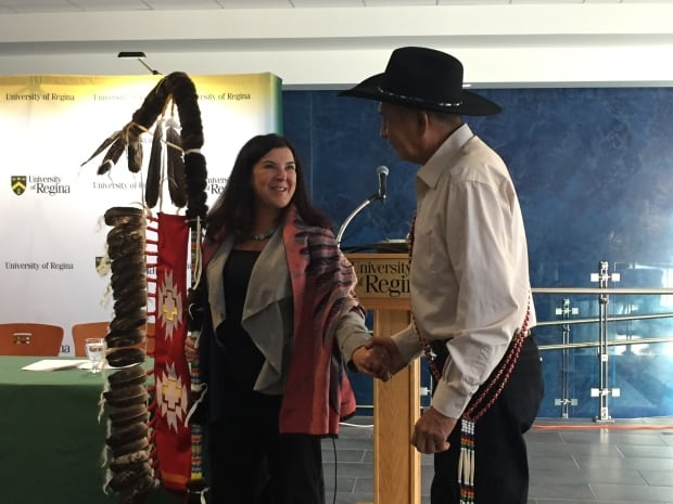 Vianne Timmons and Roy Crazy Horse Bison Eagle Staff at U of R