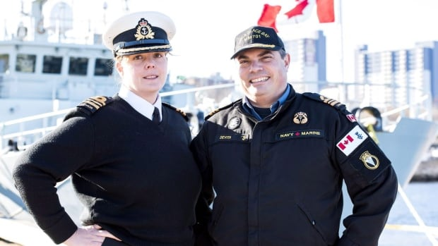 Royal Canadian Navy officers Lt.-Cmdr Victoria Devita and Lt.-Cmdr. Chris Devita are shown in this 2017 handout image. The pair has made history by becoming the first married couple to have skippered the same Canadian naval ship.