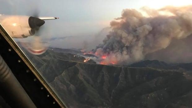 Coulson Air's Tanker 131 flies over the Thomas fire in Santa Barbara County, California Dec. 8.