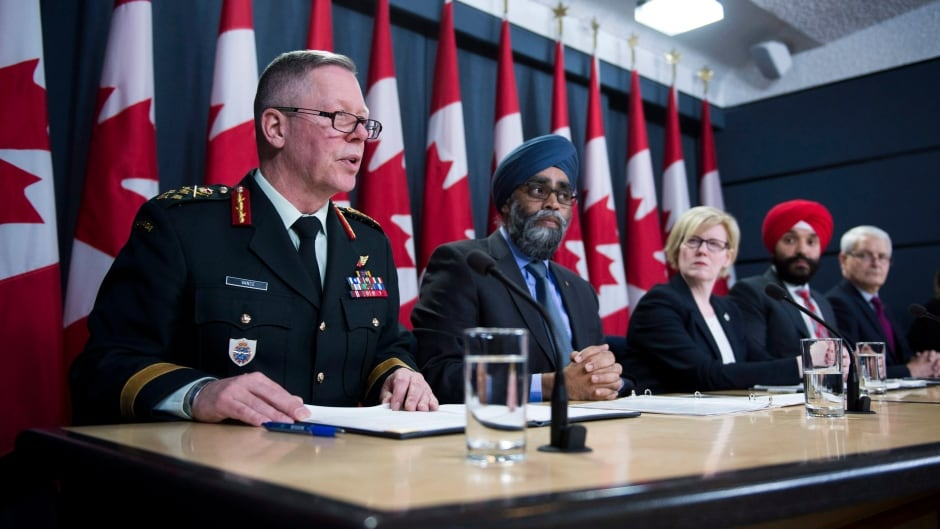 General Jonathan Vance, Chief of the Defence Staff (left to right) Defence Minister Harjit Sajjan, Carla Qualtrough, minister of public services and procurement, Navdeep Bains, minister of innovation, science and economic development and Marc Garneau, minister of transport make an announcement on fighter jets at the National Press Theatre in Ottawa on Tuesday, Dec. 12, 2017.
