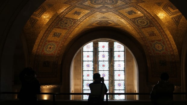 The rotunda room features a domed mosaic ceiling and stained glass window panels.