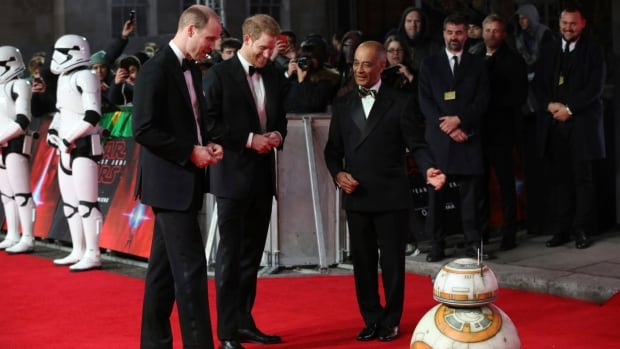 Britain's Prince William, left, and Prince Harry, centre, are introduced to android BB-8 at the London premiere of Star Wars: The Last Jedi on Tuesday.
