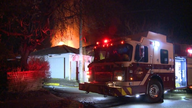 Flames from the house could be seen driving down East 12th Avenue late Tuesday night.