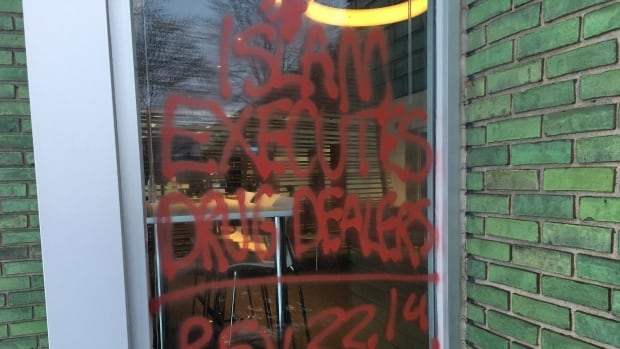 The graffiti on the windows of CBC Windsor.