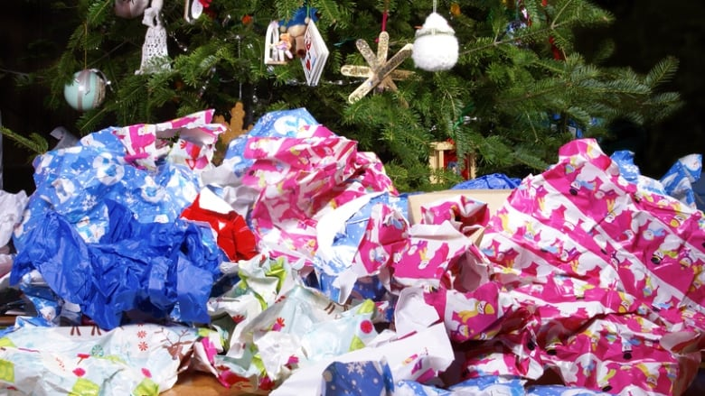 After the gifts are unwrapped, don't forget to dispose of your holiday waste responsibly. (Shutterstock)