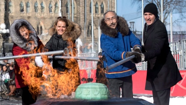 From right to left, Prime Minister Justin Trudeau, Nunavut Premier Paul Quassa, Governor General Julie Payette and Commissioner of Nunavut Nellie Kusugak reignite the Centennial Flame during a ceremony marking the addition of Nunavut, on Parliament Hill in Ottawa on Wednesday, Dec. 13, 2017.