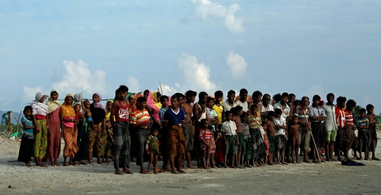 dbe64e2fa626 Arrested journalist Wa Lone photographed Rohingya Muslims waiting to cross  the border to Bangladesh from northern Rakhine state