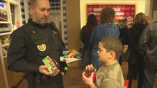 Each of the children was paired up with a police officer/personal shopper to spend their $200 on themselves and their loved ones for Christmas.