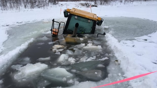 An instructor with Aurora College in Fort Smith, N.W.T., was using the Caterpillar to move some gravel around when it broke through the ice on the Salt River.