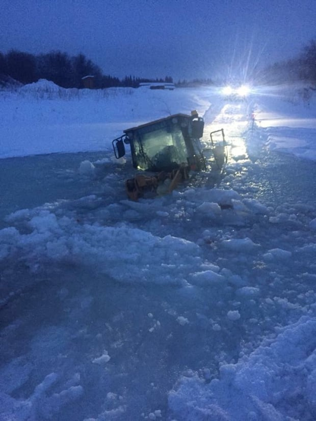 Loader gone through ice