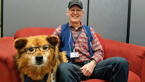 George Ames and his dog Rusty volunteer at St. Boniface Hospital three afternoons a week.