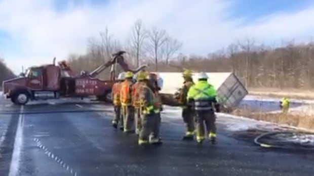 The eastbound lanes of Highway 402 will be closed for much of Thursday afternoon after two transport trucks left the roadway and crashed around 10 a.m.