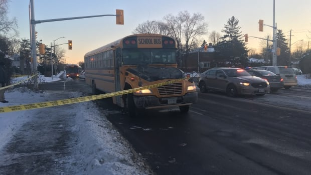 Paramedics say a woman in her 60s was run over by a school bus at Iris Street and Woodroffe Avenue Thursday afternoon.