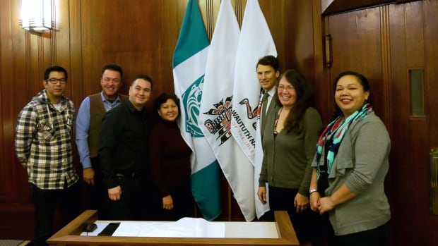From left to right: Gordon Grant from the Musqueam Nation, Richard Baker from the Squamish Nation, Morgan Guerin, also from Musqueam, Charlene Aleck from the Tsleil-Waututh Nation, Mayor Gregor Robertson, Deborah Baker from the Squamish Nation, and Michelle George from the Tsleil-Waututh Nation.
