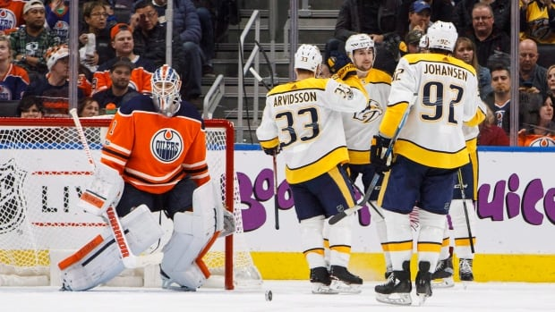 The Nashville Predators celebrate a goal as Edmonton Oilers goalie Laurent Brossoit looks on during second period at Rogers Place on Thursday.