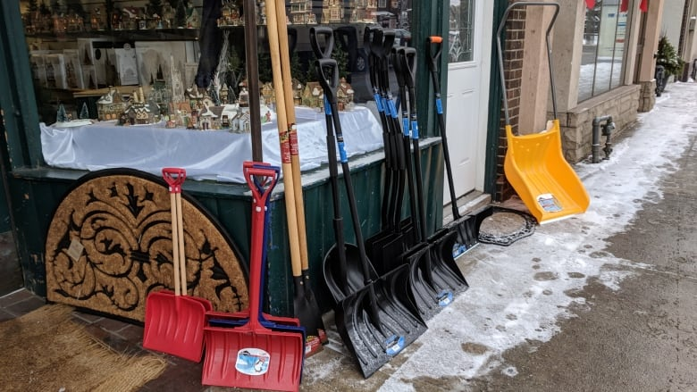 Snow shovels in front of hardware