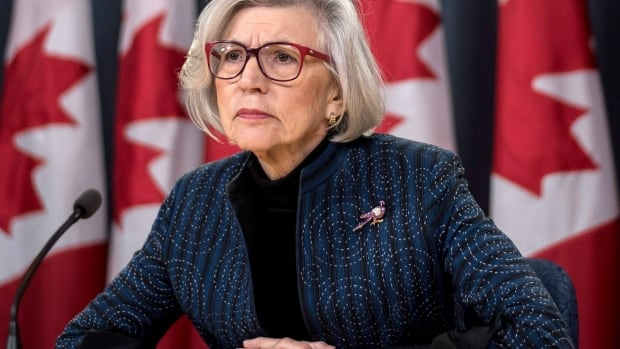 Outgoing Chief Justice of the Supreme Court of Canada Beverley McLachlin listens to a question during a final news conference in Ottawa today.