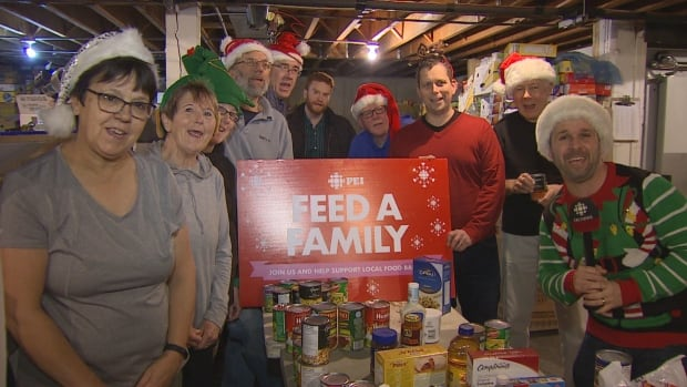 CBC P.E.I. meteorologist Jay Scotland visited the food bank on Friday to thank volunteers for their work as part of the Feed A Family campaign.