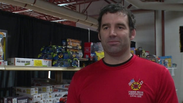 Greg Dinney says he and the other firefighters enjoy collecting toys for children in need.