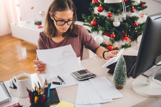 529132849 Woman looking over Christmas bills