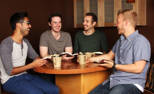 104902931  guys having coffee around table