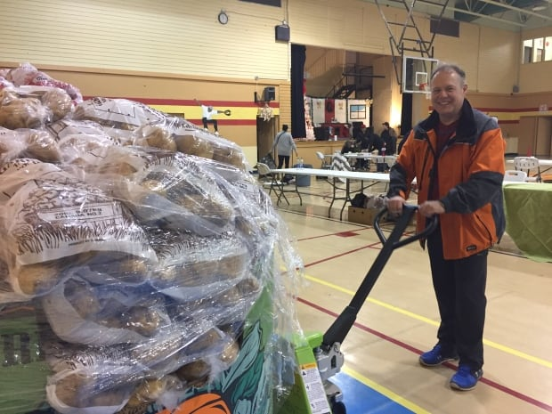 Richard Preston works at Samson Cree Nation Christmas hamper give away