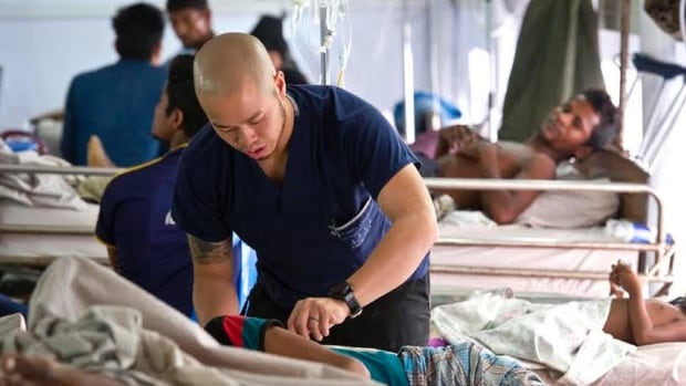 Moses Li treating a patient at the Malumghat Christian Memorial Hospital in Bangladesh during his volunteer trip earlier this fall.