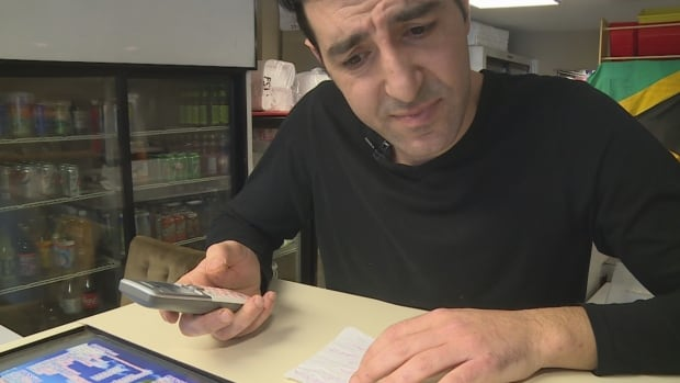 Halifax restaurant owner Elias Fathallah says the scammers had an elaborate set-up, including an official-sounding phone number and answering machine.