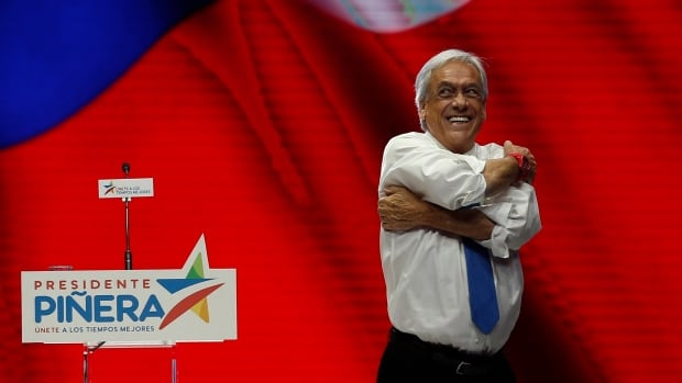 Chilean presidential candidate Sebastian Pinera smiles at supporters during his final election campaign rally in Santiago on Dec. 14.