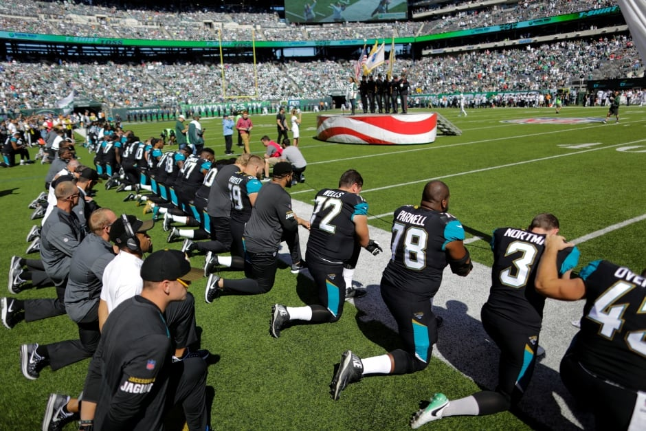 USA TRUMP NFL players kneel before the national anthem
