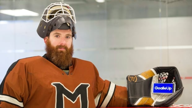 Mark Manning, creator of the app GoalieUp, poses for a portrait at a hockey rink in Montreal.