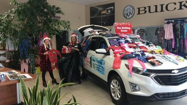 Paula Trueman, right, along with other Rotarians, helped gather nearly 1200 pairs of pyjamas for families in need this holiday season.
