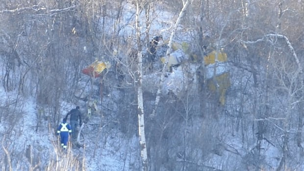 Investigators on the scene of a plane crash that killed a 60-year-old man near Baldur, Man.