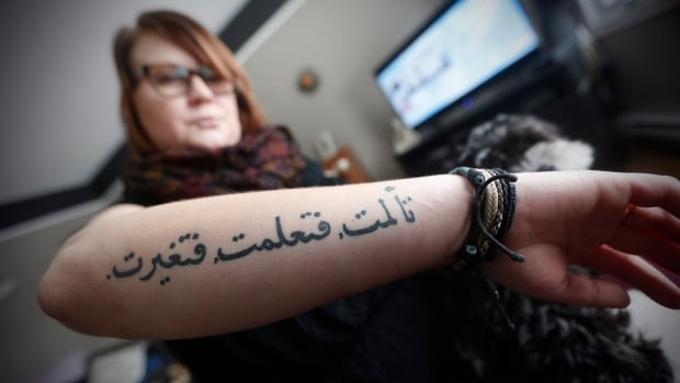 "Kristen Hiebert, who almost died in a car crash in January, 2016, shows her Arabic tattoo which she says is translated ""I lived, I suffered, I changed"" as she is photographed in her home in Boissevain, Manitoba, Thursday, November 16, 2017."