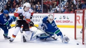 Flames rout Canucks to snap 3-game skid