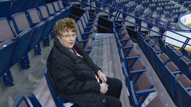 Carol Bailey sits in the seat in which she used to watch the Edmonton Oilers play at the Coliseum.