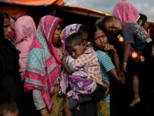 Kulsuma Begum, 40, a Rohingya refugee, cries because she has lost her daughter and she said her husband and son-in-law were killed by military in Myanmar. Bob Rae says the world needs to investigate alleged war crimes against the Rohingya Muslims.