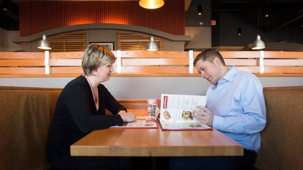Conservative Leader Andrew Scheer, right, looks over a menu with his wife Jill at a restaurant in Ottawa on Dec. 11. The line of separation between politics and home life for the Scheers is set to get a little less sharp in 2018 as the Conservatives move to position Andrew as the next best leader for the country.
