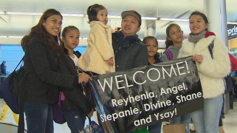Boy Felix Aseo Welcomed His Wife Reyhenia And Five Daughters To Newfoundland At The Airport On Friday Mark Cumby CBC
