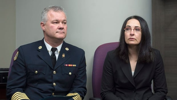 Former firefighter Liane Tessier, right, and Ken Stuebing, fire chief for Halifax Regional Fire and Emergency, attend a news conference in Halifax on Monday.