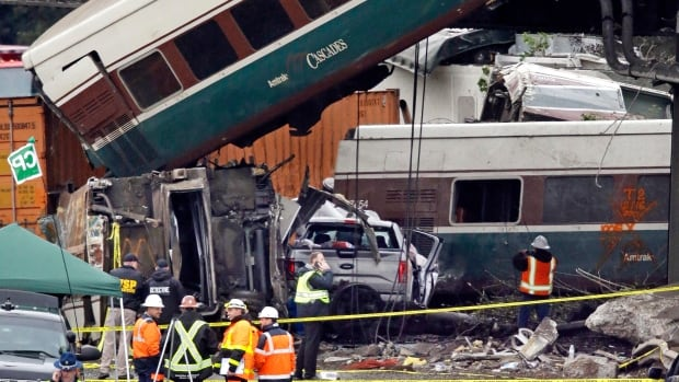 Cars from an Amtrak train that derailed above lay spilled onto Interstate 5 alongside smashed vehicles Monday, Dec. 18, 2017, in DuPont, Wash. The Amtrak train making the first-ever run along a faster new route hurtled off the overpass Monday near Tacoma and spilled some of its cars onto the highway below, killing some people, authorities said.