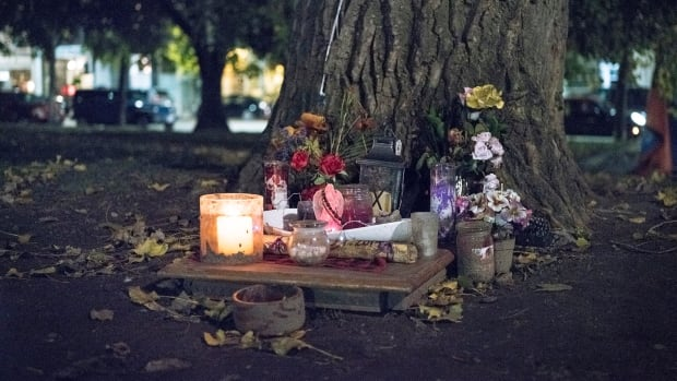 A makeshift memorial for a friend who was a drug user sits at the Moss Park overdose prevention site in downtown Toronto. Canada's top doctor says the number of people dying from drug use is a 'national public health crisis.'