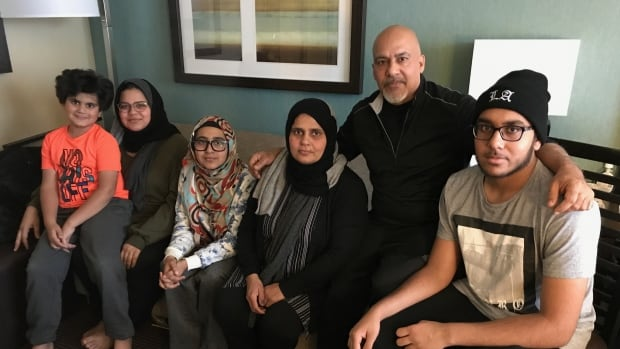 The Bhatti family has been living in a hotel since they were forced from their flooded home in May. From left: Minah, 8, Bia, 19, Tuba, 13, Weena Sehar, Tauseef Bhatti and Aadn, 15.