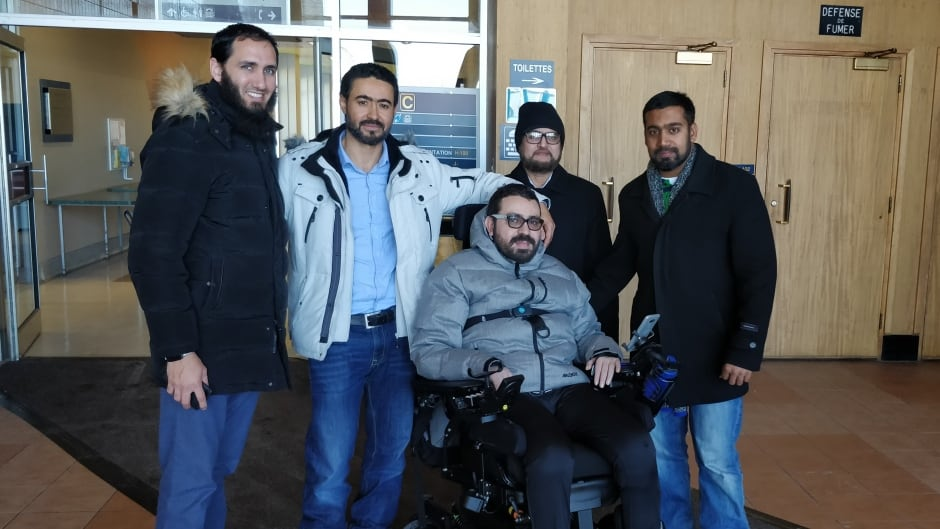 Aymen Derbali, centre, is paralyzed and therefore can no longer live with his family in their fourth-floor apartment. The community is rallying to raise money for a new home.