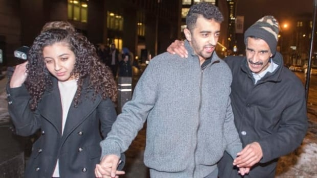 Sabrine Djermane, El Mahdi Jamali, centre, and his father leave the courthouse after the couple was acquitted of terror-related charges Dec. 19. The pair is now helping Quebec's anti-radicalization centre develop a guide to support people charged with terror offences.