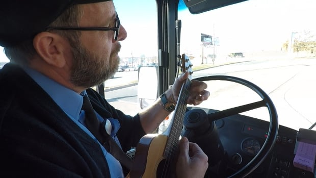 Halifax Transit driver Peter Stephenson entertains himself and his passengers with a few tunes while they wait.
