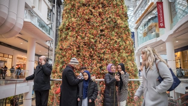 Toronto's Eaton Centre was filled with shoppers Thursday, with many more expected Friday before the start of the Christmas holiday.