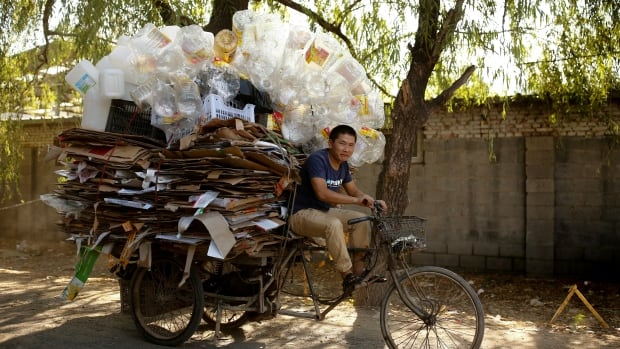 A scrap collector delivers recyclables on a tricycle to a recycling yard in Beijing, China. Calgary is looking for new markets to sell recyclables to following a ban by the Chinese on recycled materials.