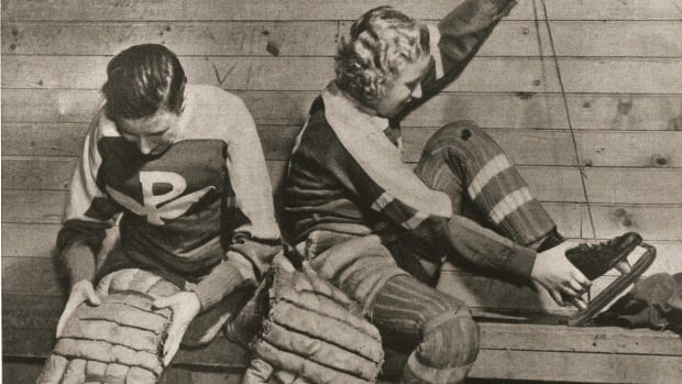 Two Preston Rivulette players preparing for a game. The women on the team were softball players, looking for something to do during the off season.
